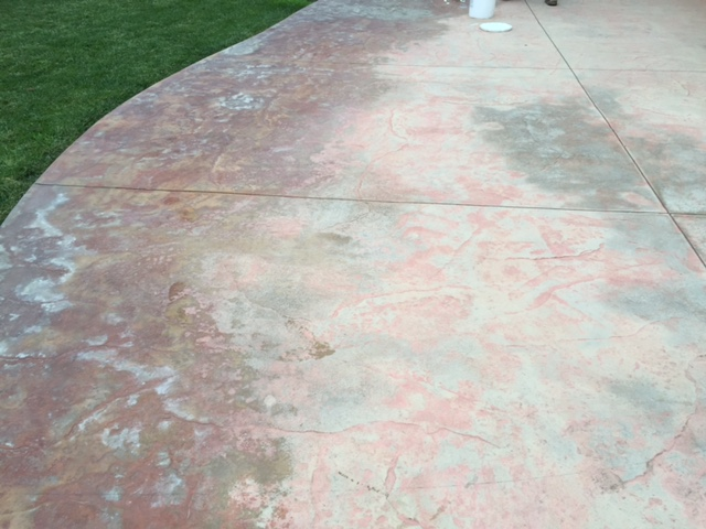 A Worn, Discolored, Stamped Patio   Before